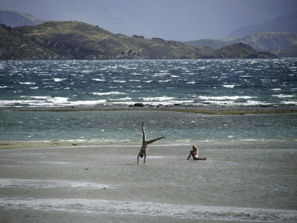 Hand stand in the wind, Lake Wanaka